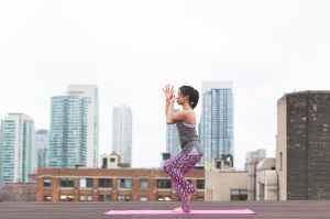 photo of woman wearing gray tank top and purple floral pants